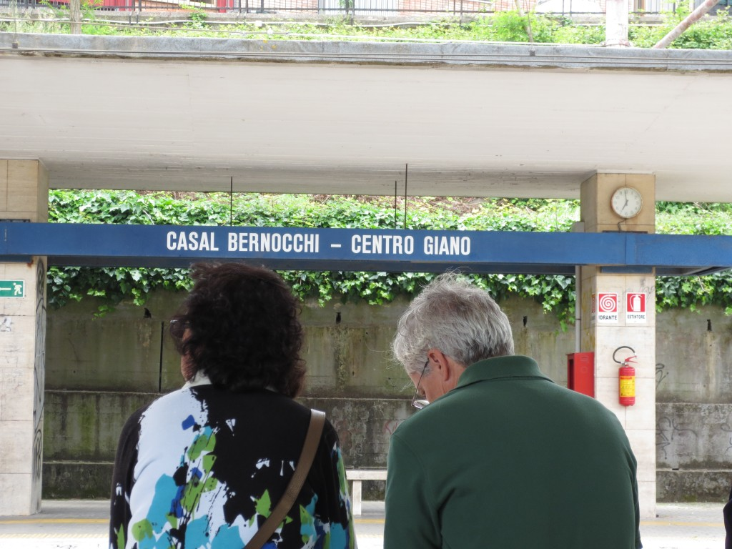 Mom and dad waiting for the train at Casal Bernocchi - Centro Giano