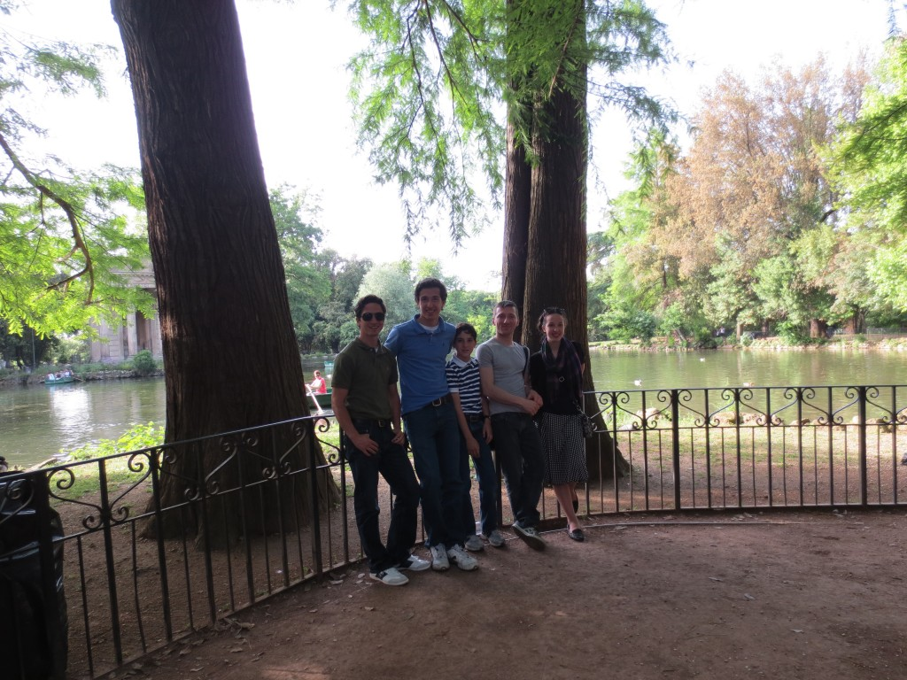 De Piante family and Alby in front of the pond in Villa Borghese, Rome, Italy.