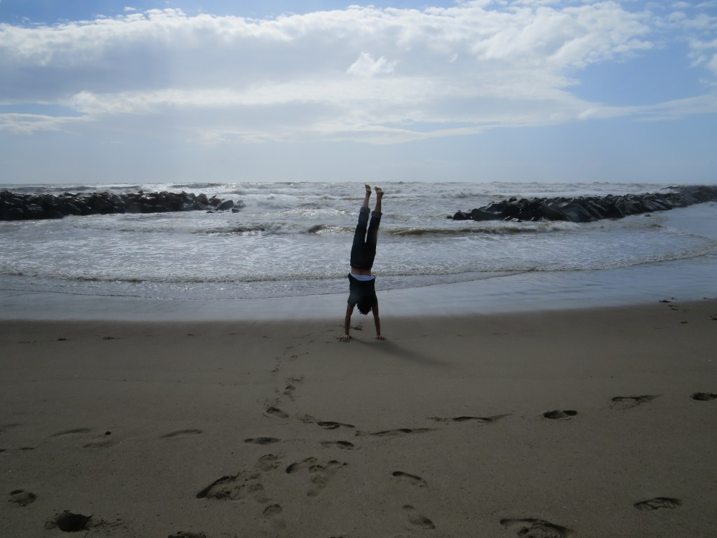 Andrew doing a handstand at Ostia beach, Rome, Italy